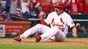 ST LOUIS, MO - OCTOBER 09: Stephen Piscotty #55 of the St. Louis Cardinals celebrates scoring a run in the first inning against the Chicago Cubs during game one of the National League Division Series at Busch Stadium on October 9, 2015 in St Louis, Missouri. (Photo by Dilip Vishwanat/Getty Images)